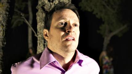 Mack Dragoni (Tom Malloy) fears for his life and the lives of his female companions in HOUSE OF MANY SORROWS