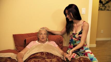 Caretaker Loni Blake (Samantha Brownlee) takes care of dying woman Murial Caverly (Betty Maxwell) in HOUSE OF MANY SORROWS