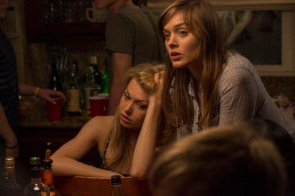"(L-R) Penelope Mitchell as Tracy and Bella Heathcote as Chrissie in the thriller ""THE CURSE OF DOWNERS GROVE"" an Anchor Bay Entertainment release.  Photography credit: Bryan Giardinelli."
