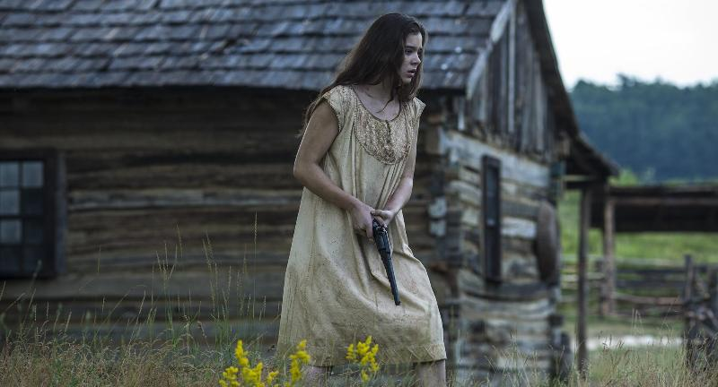 Keeping_Room-Armed: Louise (Hailee Steinfeld) prepares to fend off encroaching attackers in Drafthouse Films' The Keeping Room. Courtesy of Drafthouse Films.
