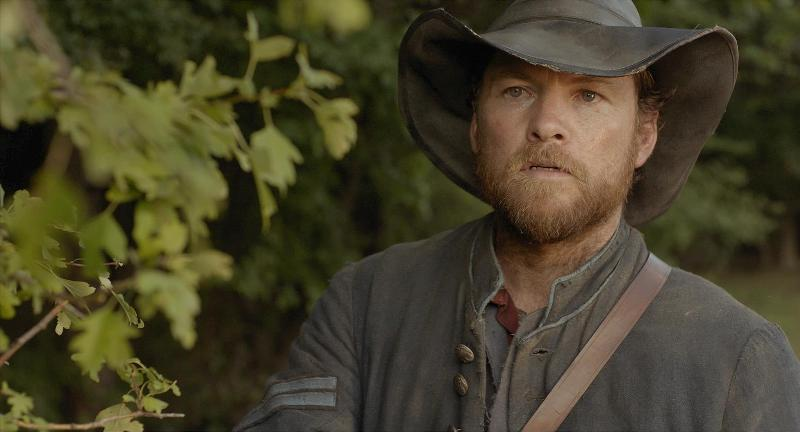 Keeping_Room-Track: Renegade Union soldier Moses (Sam Worthington) on the trail of Augusta (Brit Marling) after a chance encounter in Drafthouse Films' The Keeping Room. Courtesy of Drafthouse Films.