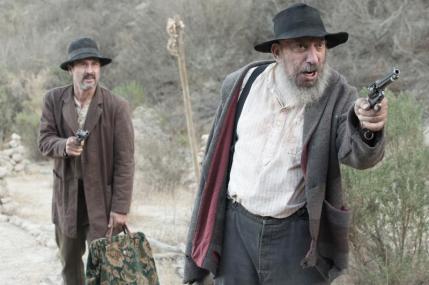 "(L-R): David Arquette as Purvis and Sid Haig as Buddy in the western film ""BONE TOMAHAWK"" an RLJ Entertainment release. Photo credit: Scott Everett White."