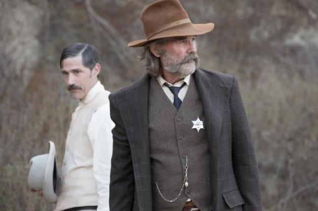"(L-R): Matthew Fox as John Brooder and Kurt Russell as Sheriff Franklin Hunt in the western film ""BONE TOMAHAWK"" an RLJ Entertainment release. Photo credit: Scott Everett White."