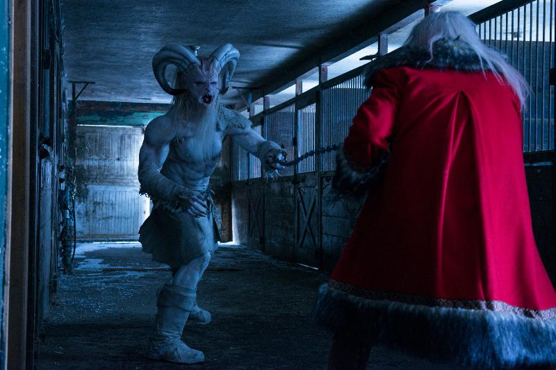 "(L-R): Rob Archer as Krampus and George Buza as Santa in the horror film ""A CHRISTMAS HORROR STORY"" an RLJ Entertainment release. Photo credit: RLJ Entertainment."