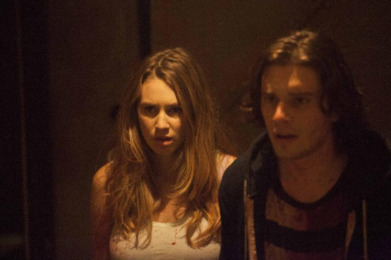 """(L-R): Dylan Penn as Maya and Ronen Rubinstein as Dante in the horror film """"CONDEMNED"""" an RLJ Entertainment release. Photo credit: Paul Sarkis."""