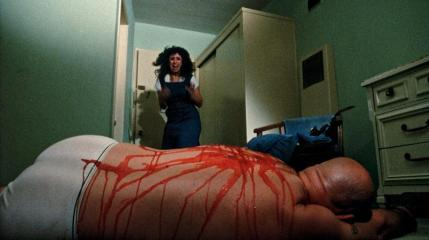 Dangerous_Men-Scream: The room maid (Donna Ohana) finds a dead body in Drafthouse Films' Dangerous Men. Courtesy of Drafthouse Films.