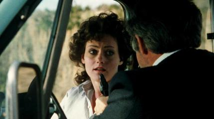 Dangerous_Men-Point-Blank: Mira is held at gunpoint by a truck driver (John Drake) in Drafthouse Films' Dangerous Men. Courtesy of Drafthouse Films.