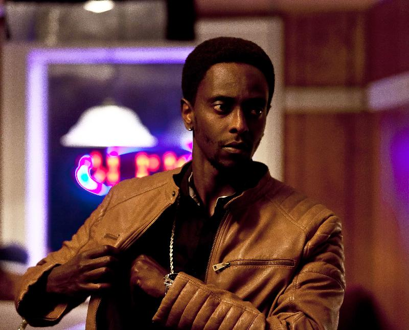 """Edi Gathegi as Marques in the thriller """"CRIMINAL ACTIVITIES"""" an RLJ Entertainment release. Photo credit: Grant F. Fitch."""