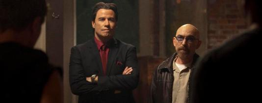 """(L-R): John Travolta as Eddie and Jackie Earle Haley as Gerry in the thriller """"CRIMINAL ACTIVITIES"""" an RLJ Entertainment release. Photo credit: Grant F. Fitch."""