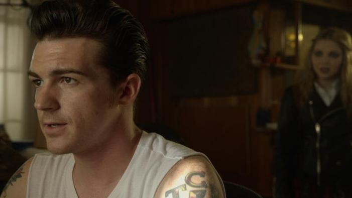 "[L-R] Drake Bell as Ben and Sammi Hanratty as Siouxsie Hess in the thriller ""BAD KIDS OF CRESTVIEW ACADEMY"" a Momentum Pictures release. Photo courtesy of Momentum Pictures."