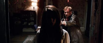 "[L-R] Jessica Lowndes as Julia Talben and Joe Anderson as Declan Grady in the horror film ""ABATTOIR"" a Momentum Pictures release. Photo courtesy of Momentum Pictures."