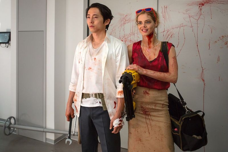 "(L-R) Steven Yeun as Derek Cho and Samara Weaving as Melanie Cross in the horror, action ""MAYHEM"" an RLJE Films release. Photo courtesy of Sanja Bucko."