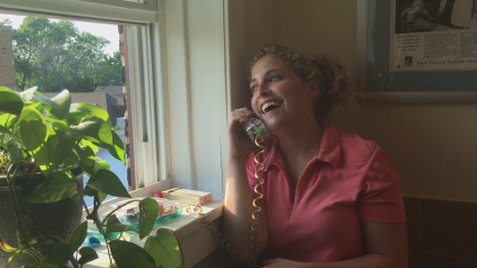 Cindy (Mariah Michael) is amused and grossed out by something her friend Carol just said.